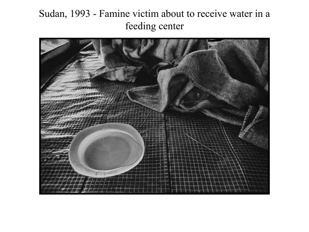 Sudan, 1993 - Famine victim about to receive water in a feeding center