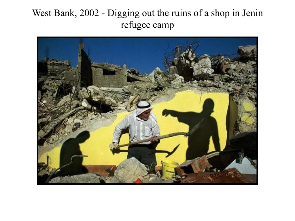 West Bank, 2002 - Digging out the ruins of a shop in Jenin refugee camp