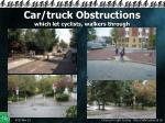 car truck obstructions which let cyclists walkers through