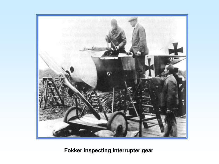 Fokker inspecting interrupter gear