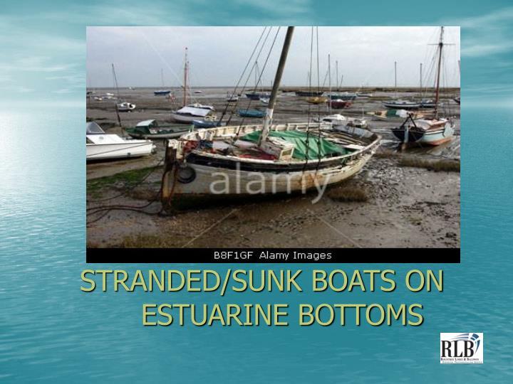 Stranded sunk boats on estuarine bottoms