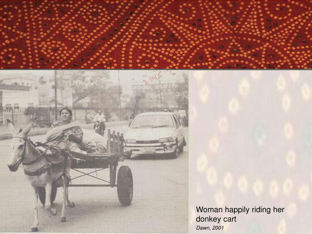 Woman happily riding her donkey cart