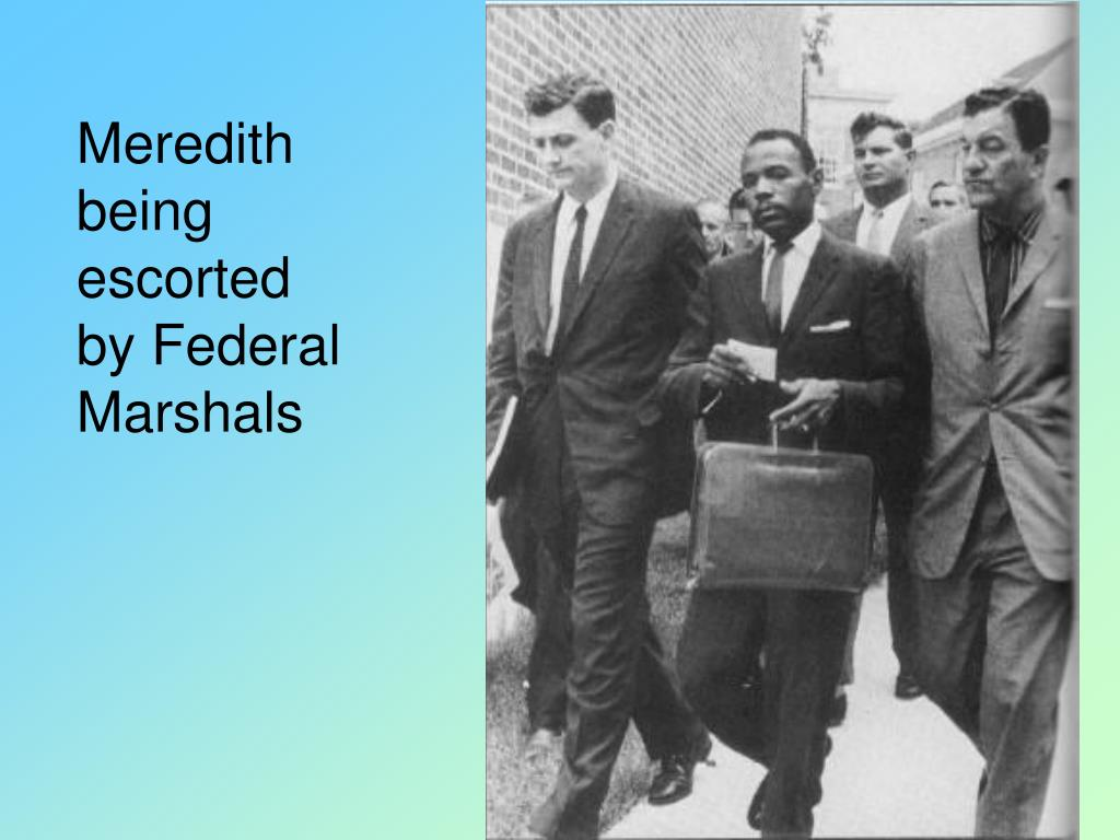 Meredith being escorted by Federal Marshals