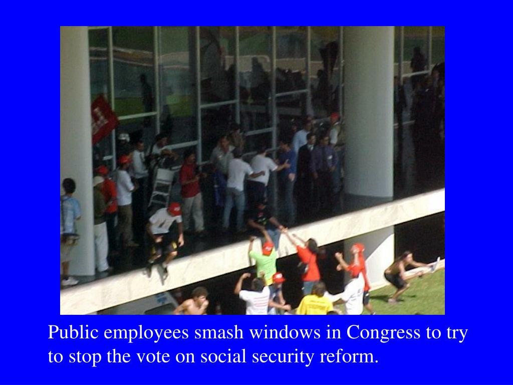 Public employees smash windows in Congress to try to stop the vote on social security reform.