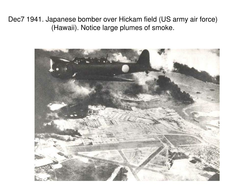 Dec7 1941. Japanese bomber over Hickam field (US army air force) (Hawaii). Notice large plumes of smoke.