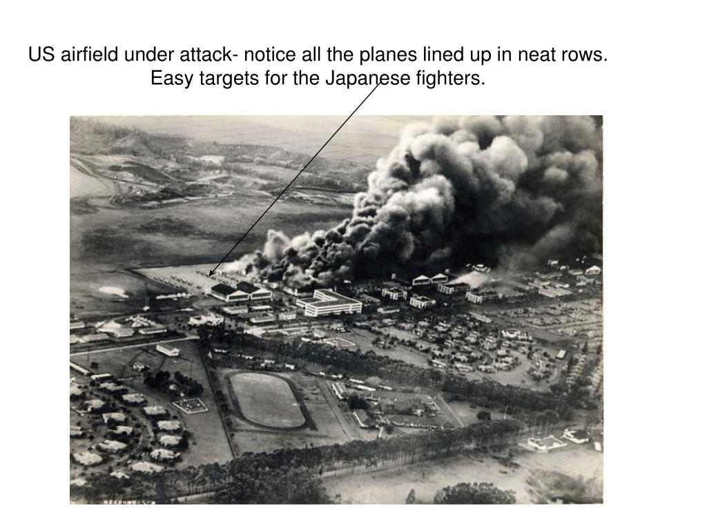 US airfield under attack- notice all the planes lined up in neat rows. Easy targets for the Japanese fighters.