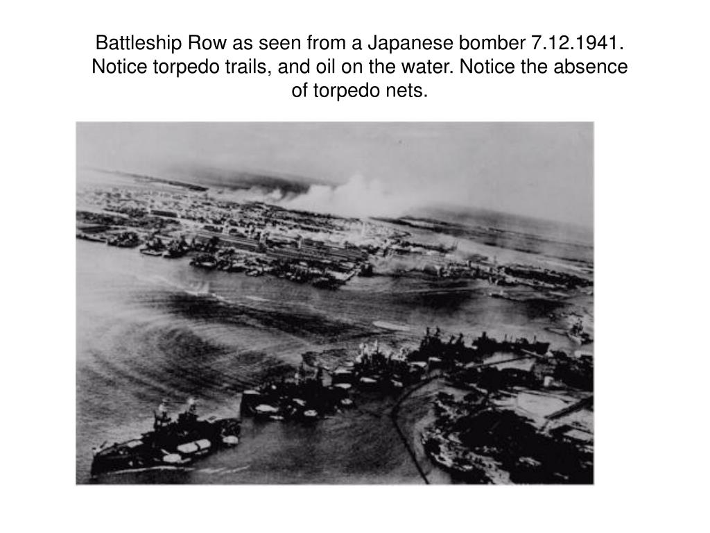 Battleship Row as seen from a Japanese bomber 7.12.1941. Notice torpedo trails, and oil on the water. Notice the absence of torpedo nets.
