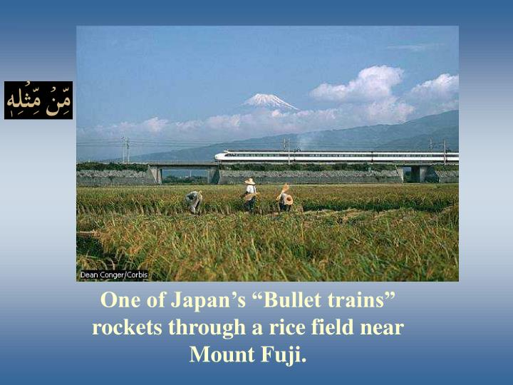 "One of Japan's ""Bullet trains"" rockets through a rice field near Mount Fuji."