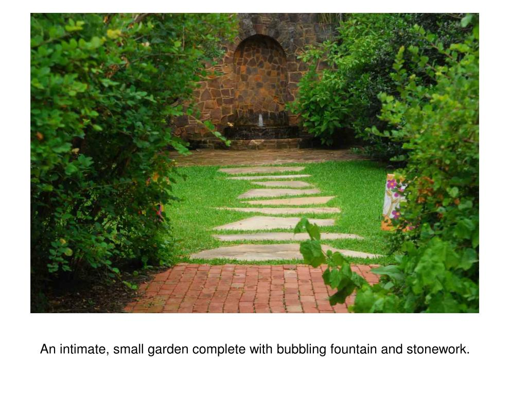 An intimate, small garden complete with bubbling fountain and stonework.