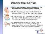 donning hearing plugs