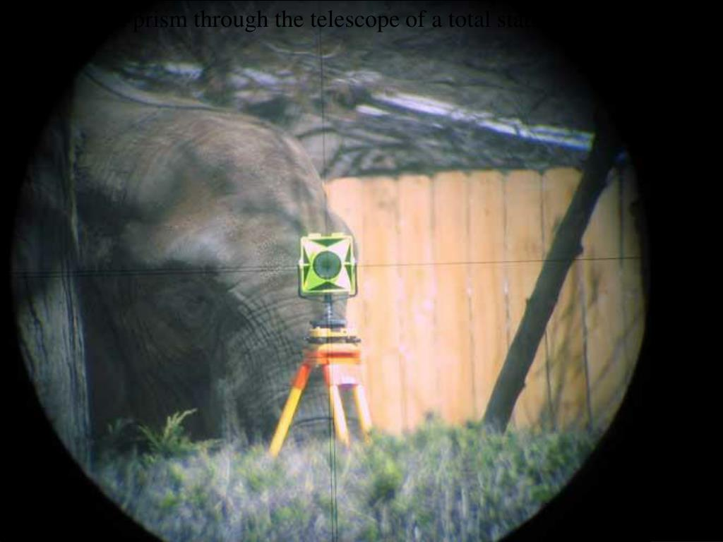 Aiming at  a prism through the telescope of a total station in a zoo!