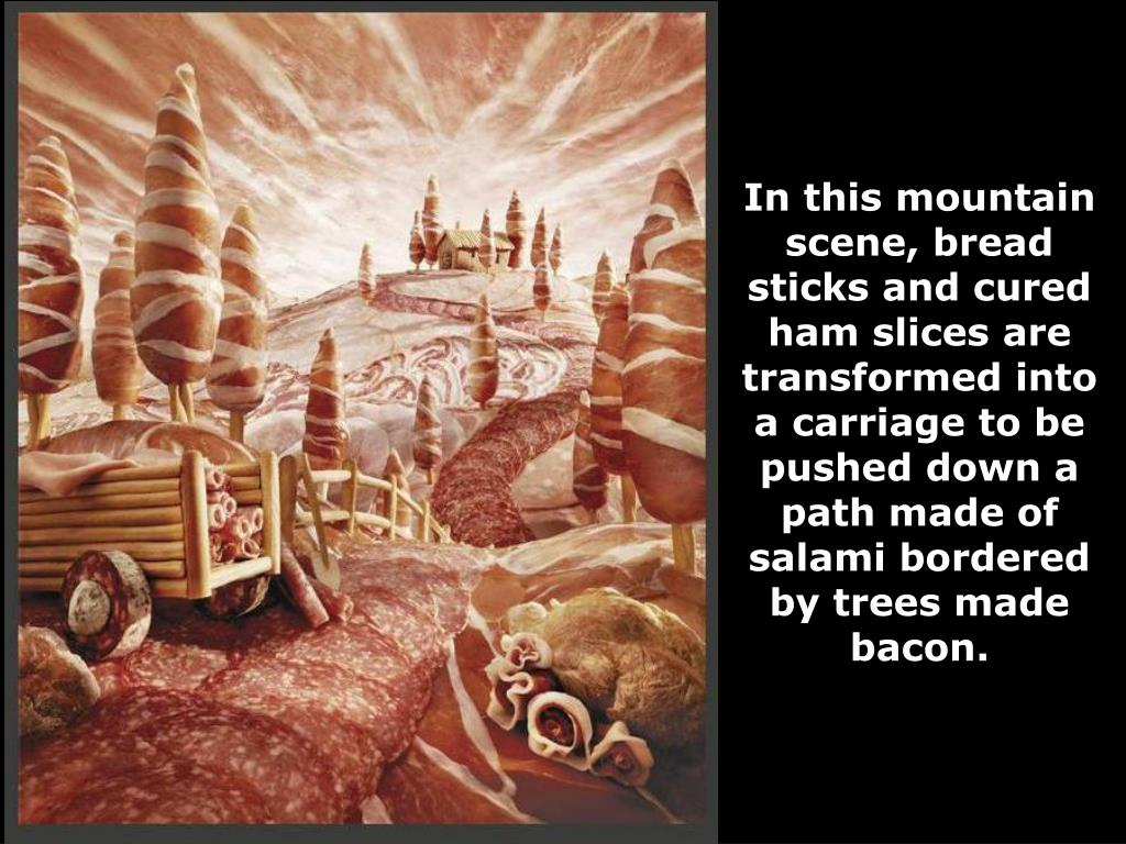 In this mountain scene, bread sticks and cured ham slices are transformed into a carriage to be pushed down a path made of salami bordered by trees made bacon.