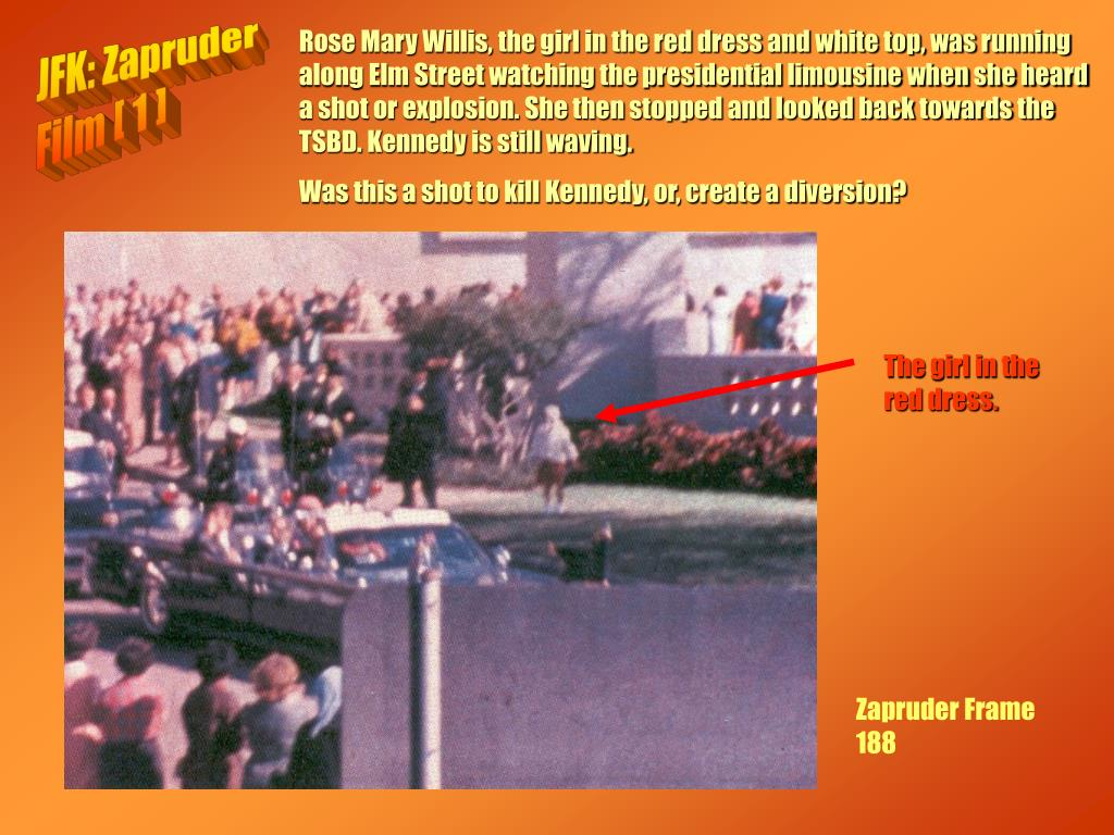 Rose Mary Willis, the girl in the red dress and white top, was running along Elm Street watching the presidential limousine when she heard a shot or explosion. She then stopped and looked back towards the TSBD. Kennedy is still waving.