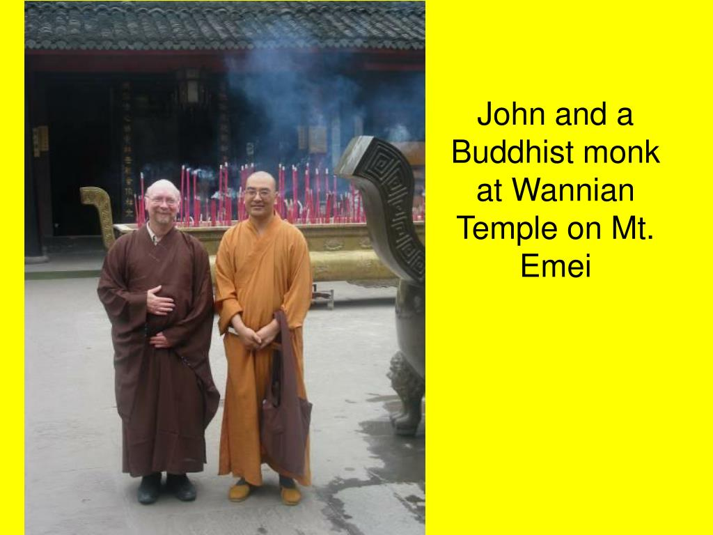 John and a Buddhist monk at Wannian Temple on Mt. Emei