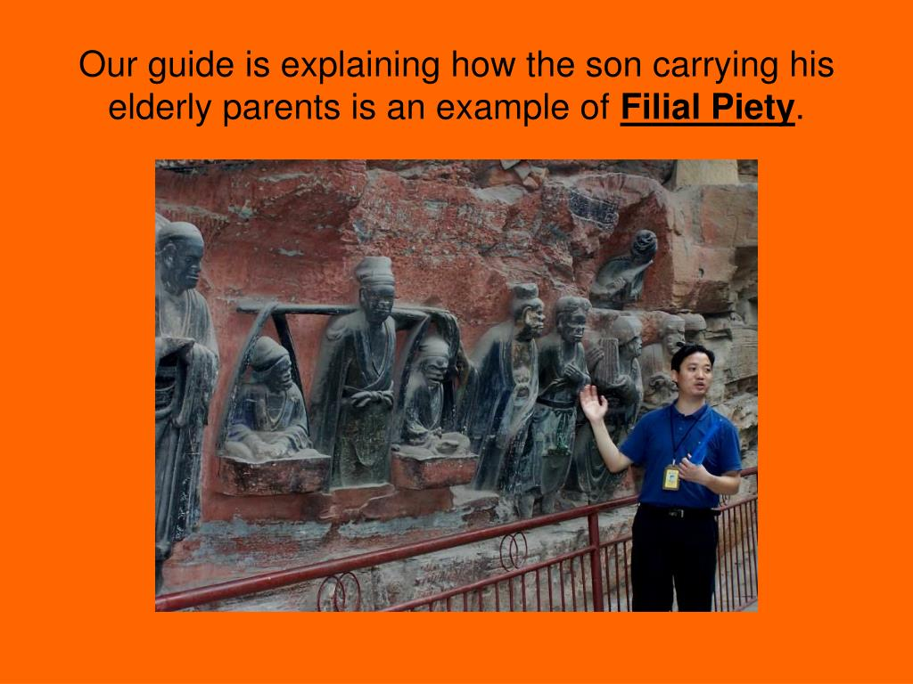 Our guide is explaining how the son carrying his elderly parents is an example of