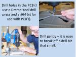 drill holes in the pcb i use a dremel tool drill press and a 64 bit for use with pcb s