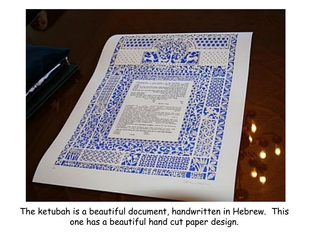 The ketubah is a beautiful document, handwritten in Hebrew.  This one has a beautiful hand cut paper design.