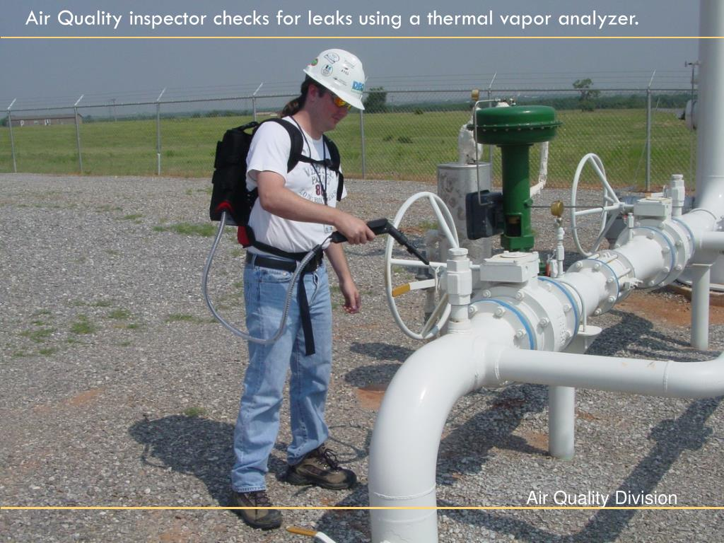Air Quality inspector checks for leaks using a thermal vapor analyzer.