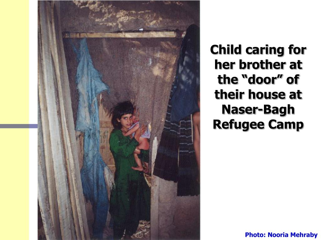 """Child caring for her brother at the """"door"""" of their house at Naser-Bagh Refugee Camp"""