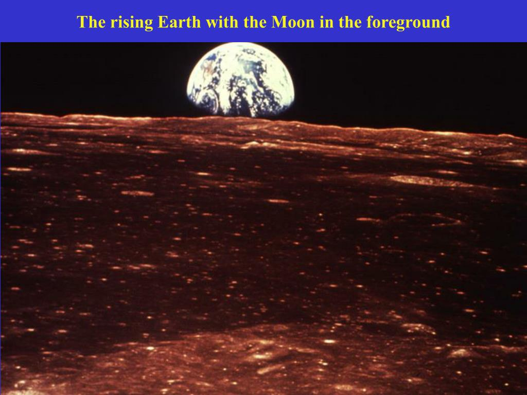The rising Earth with the Moon in the foreground