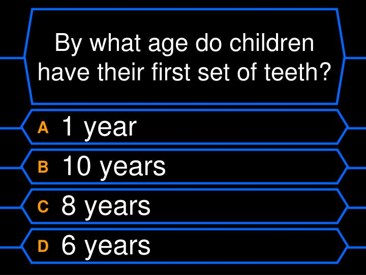 By what age do children have their first set of teeth?