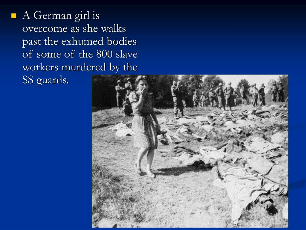 A German girl is overcome as she walks past the exhumed bodies of some of the 800 slave workers murdered by the SS guards.