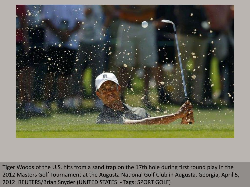 Tiger Woods of the U.S. hits from a sand trap on the 17th hole during first round play in the 2012 Masters Golf Tournament at the Augusta National Golf Club in Augusta, Georgia, April 5, 2012. REUTERS/Brian Snyder (UNITED STATES  - Tags: SPORT GOLF)