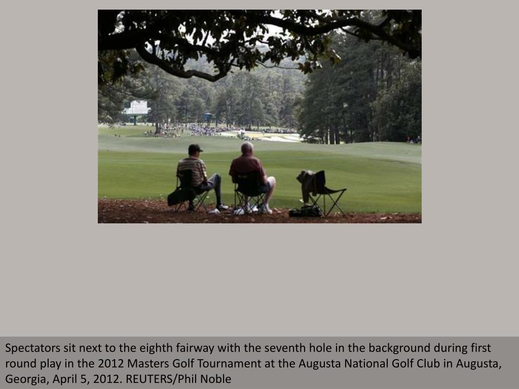 Spectators sit next to the eighth fairway with the seventh hole in the background during first round play in the 2012 Masters Golf Tournament at the Augusta National Golf Club in Augusta, Georgia, April 5, 2012. REUTERS/Phil Noble