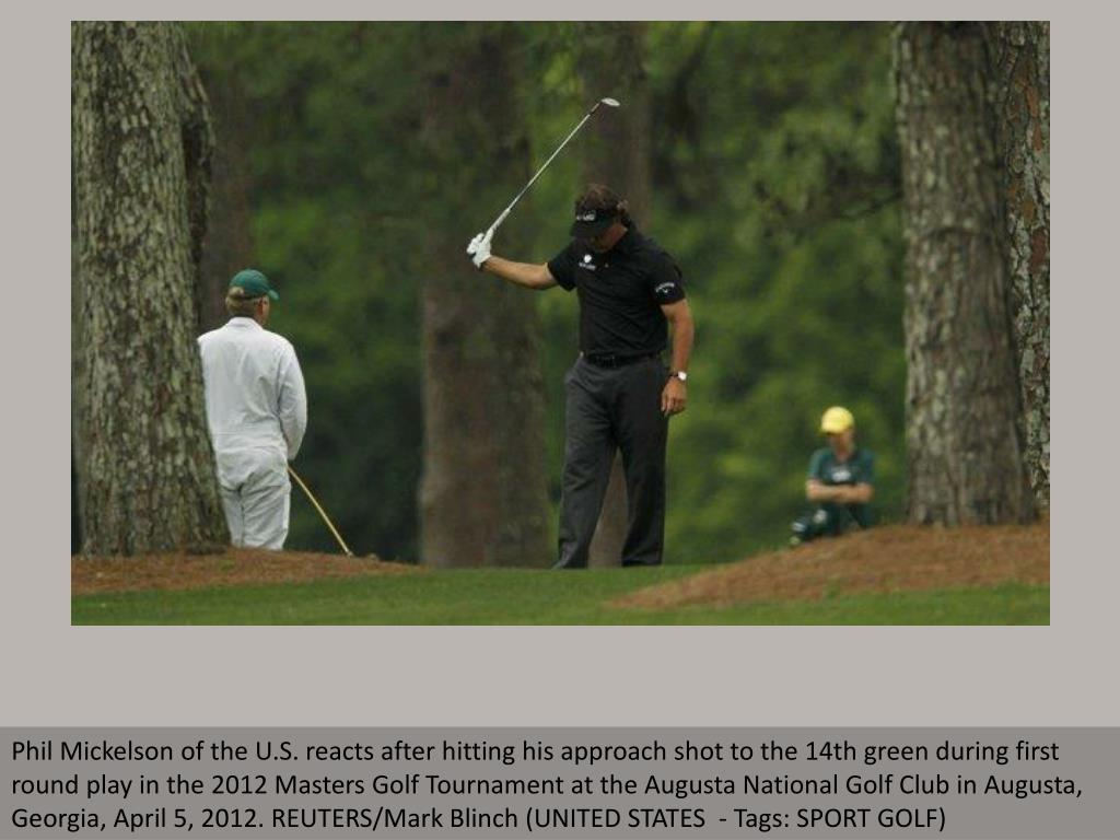Phil Mickelson of the U.S. reacts after hitting his approach shot to the 14th green during first round play in the 2012 Masters Golf Tournament at the Augusta National Golf Club in Augusta, Georgia, April 5, 2012. REUTERS/Mark Blinch (UNITED STATES  - Tags: SPORT GOLF)