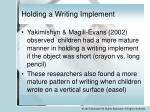 holding a writing implement4