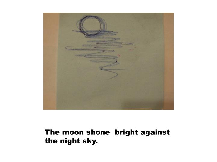 The moon shone  bright against the night sky.