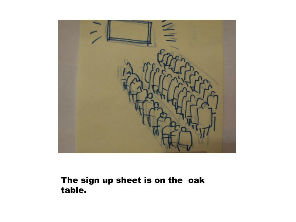 The sign up sheet is on the  oak table.
