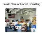 inside store with world record flag