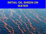 initial oil sheen on water