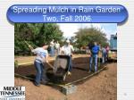 spreading mulch in rain garden two fall 2006