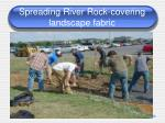 spreading river rock covering landscape fabric