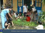 children learn how to work in a garden