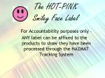 the hot pink smiley face label