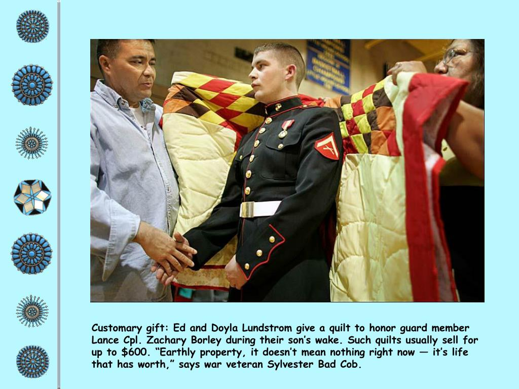 "Customary gift: Ed and Doyla Lundstrom give a quilt to honor guard member Lance Cpl. Zachary Borley during their son's wake. Such quilts usually sell for up to $600. ""Earthly property, it doesn't mean nothing right now — it's life that has worth,"" says war veteran Sylvester Bad Cob."