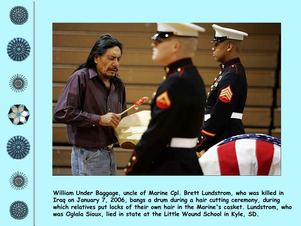 William Under Baggage, uncle of Marine Cpl. Brett Lundstrom, who was killed in Iraq on January 7, 2006, bangs a drum during a hair cutting ceremony, during which relatives put locks of their own hair in the Marine's casket. Lundstrom, who was Oglala Sioux, lied in state at the Little Wound School in Kyle, SD.