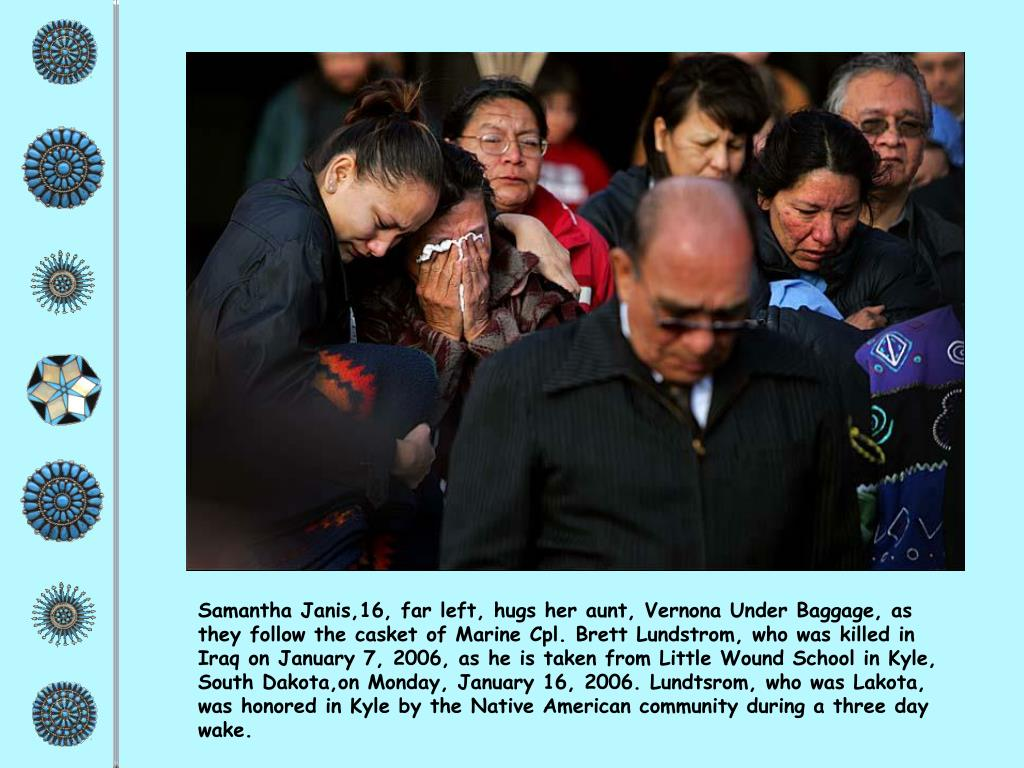 Samantha Janis,16, far left, hugs her aunt, Vernona Under Baggage, as they follow the casket of Marine Cpl. Brett Lundstrom, who was killed in Iraq on January 7, 2006, as he is taken from Little Wound School in Kyle, South Dakota,on Monday, January 16, 2006. Lundtsrom, who was Lakota, was honored in Kyle by the Native American community during a three day wake.
