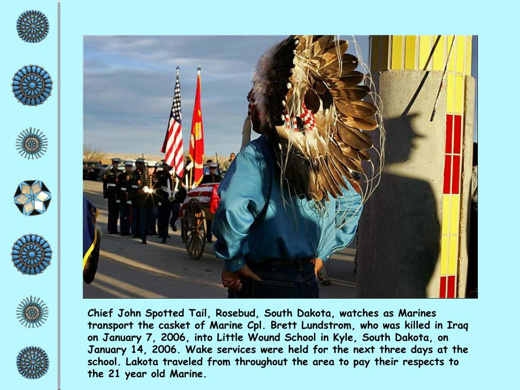 Chief John Spotted Tail, Rosebud, South Dakota, watches as Marines transport the casket of Marine Cpl. Brett Lundstrom, who was killed in Iraq on January 7, 2006, into Little Wound School in Kyle, South Dakota, on January 14, 2006. Wake services were held for the next three days at the school. Lakota traveled from throughout the area to pay their respects to the 21 year old Marine.