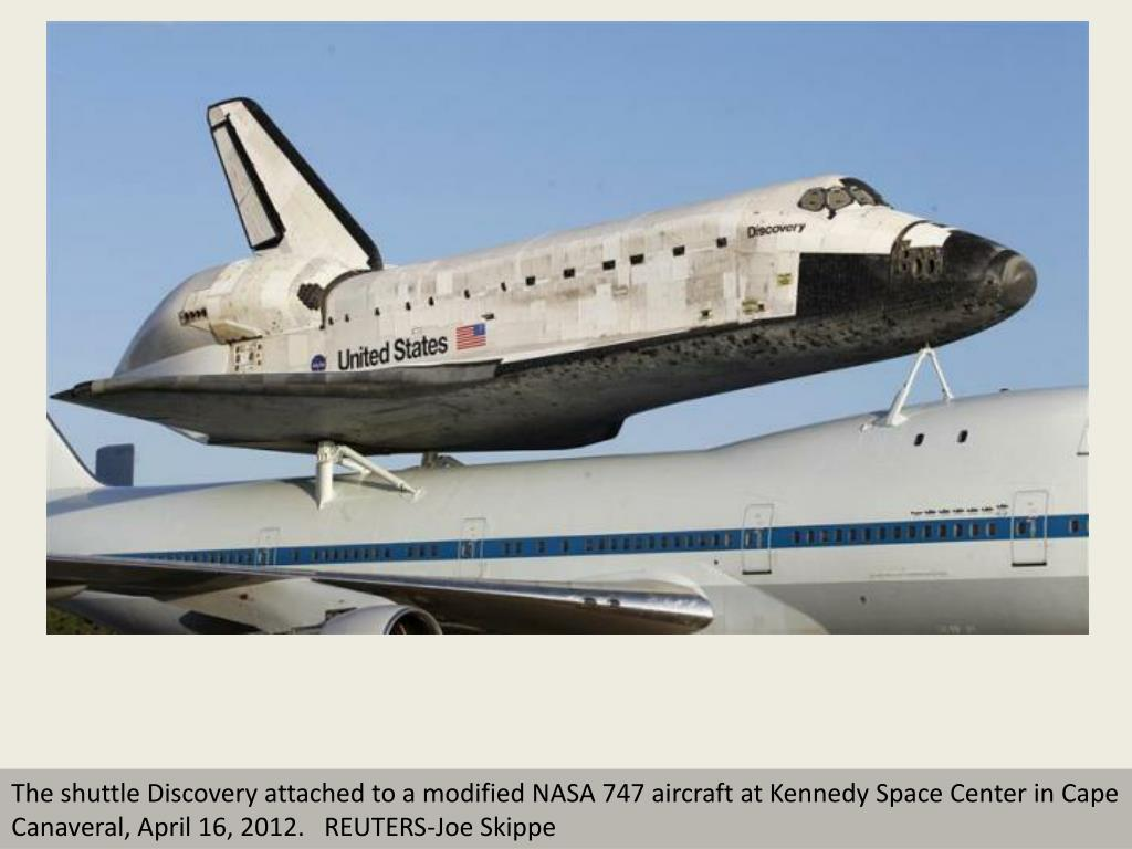 The shuttle Discovery attached to a modified NASA 747 aircraft at Kennedy Space Center in Cape Canaveral, April 16, 2012.   REUTERS-Joe Skippe