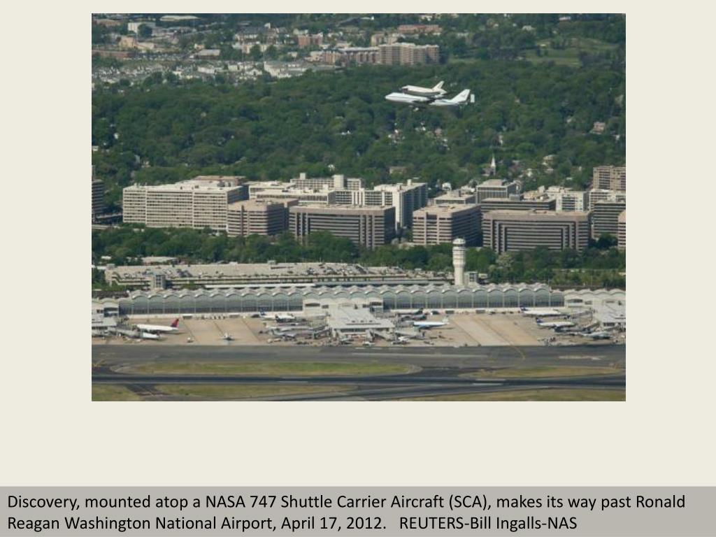 Discovery, mounted atop a NASA 747 Shuttle Carrier Aircraft (SCA), makes its way past Ronald Reagan Washington National Airport, April 17, 2012.   REUTERS-Bill Ingalls-NAS