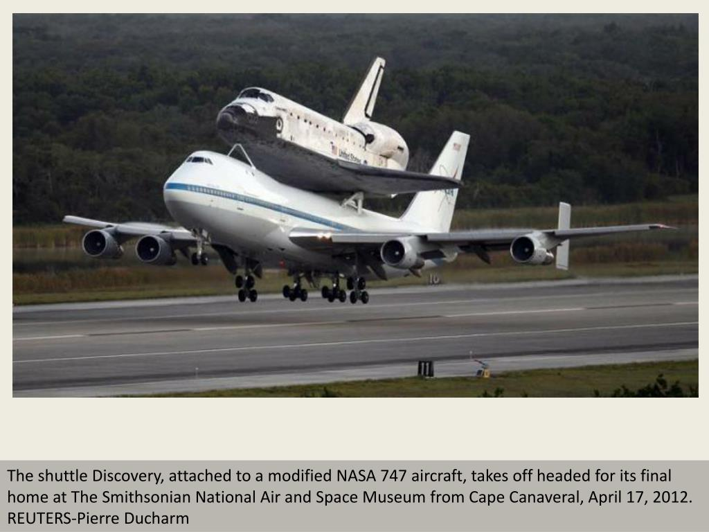 The shuttle Discovery, attached to a modified NASA 747 aircraft, takes off headed for its final home at The Smithsonian National Air and Space Museum from Cape Canaveral, April 17, 2012.  REUTERS-Pierre Ducharm