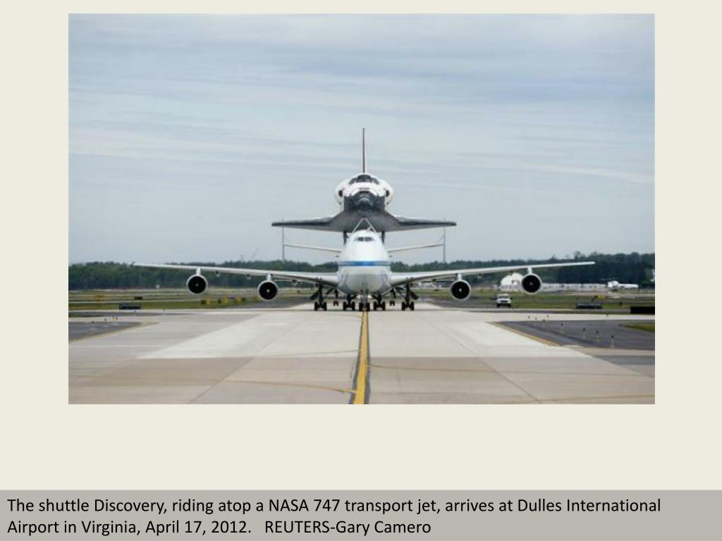 The shuttle Discovery, riding atop a NASA 747 transport jet, arrives at Dulles International Airport in Virginia, April 17, 2012.   REUTERS-Gary Camero
