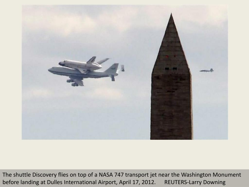 The shuttle Discovery flies on top of a NASA 747 transport jet near the Washington Monument before landing at Dulles International Airport, April 17, 2012.      REUTERS-Larry Downing