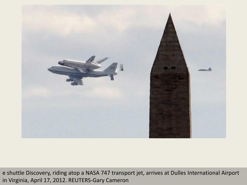 e shuttle Discovery, riding atop a NASA 747 transport jet, arrives at Dulles International Airport in Virginia, April 17, 2012. REUTERS-Gary Cameron