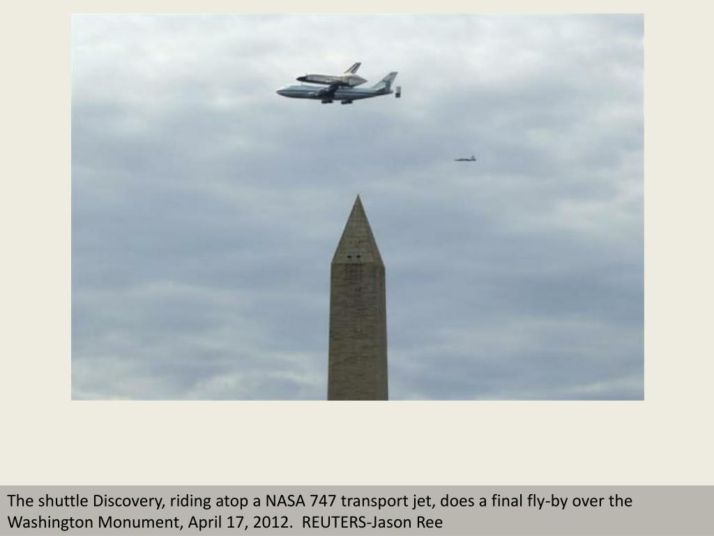 The shuttle Discovery, riding atop a NASA 747 transport jet, does a final fly-by over the Washington Monument, April 17, 2012.  REUTERS-Jason Ree