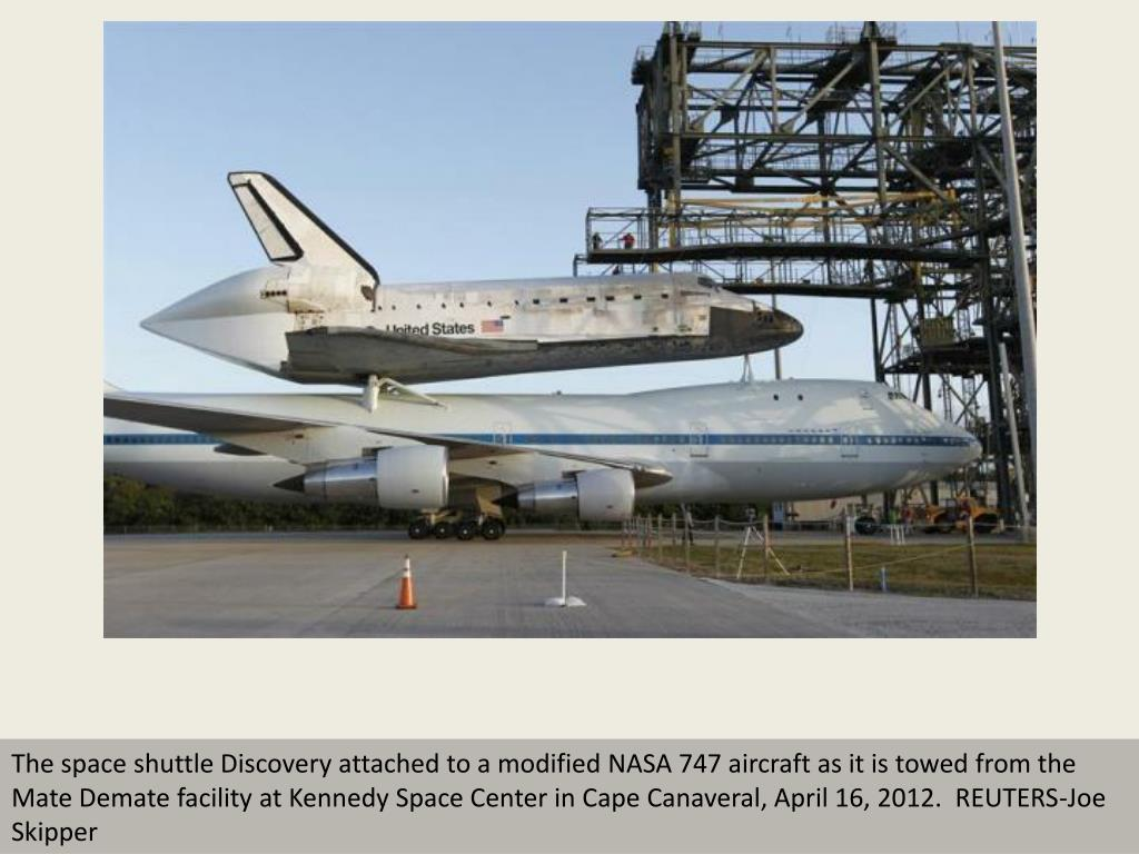 The space shuttle Discovery attached to a modified NASA 747 aircraft as it is towed from the Mate Demate facility at Kennedy Space Center in Cape Canaveral, April 16, 2012.  REUTERS-Joe Skipper